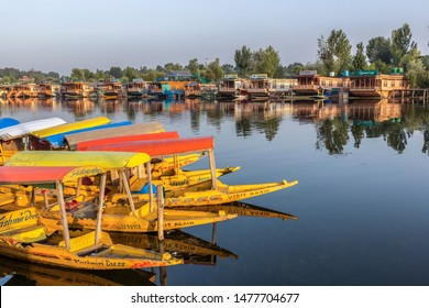 unidentified shikaras or boats are parked in dal lake for tourists in jammu and kashmir, india on june 24, 2018