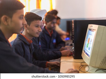 unidentified students studying in computers in classroom in ludhiana, punjab, india on 26 november 2016