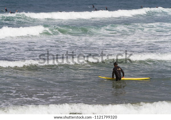 Unidentified surfers at Morro Bay, California, USA, circa September 2012