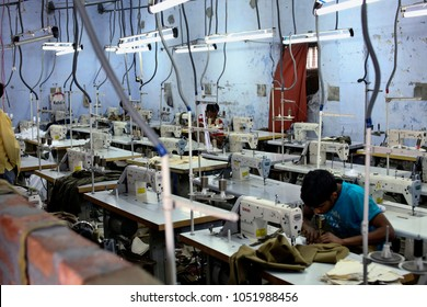 unidentified tailors sewing some clothes in a factory near ludhiana, punjab, india on 10 october 2013