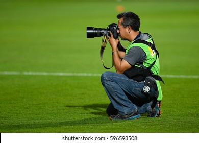 Unidentified Thai sports photographer with Nikon in during the The Toyota Thai League 2017 match between Muangthong United and Sukhothai FC. at SCG Stadium on February 17, 2017 in Thailand.