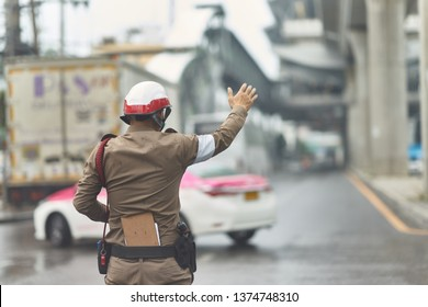 Unidentified Thai traffic policeman in working action