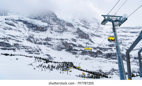 Unidentified tourists prepare to play ski  sit in Cables at the Jungfraujoch Ski Region in Switzerland.