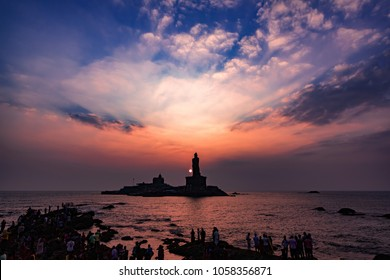 Unidentified tourists take a sunset view of Swami Vivekananda Memorial rock and thiruvalluvar island in Kanyakumari, India
