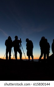 Unidentified tourists are waiting for sunrise at viewpoint on top of mountain. - (Long exposure)