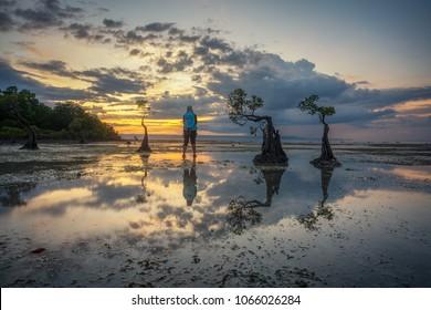 Unidentified traveler at Walakiri beach during sunset scenery.