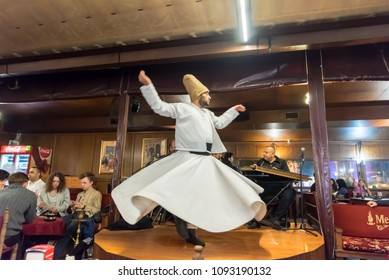 Unidentified Turkish dervish man performs Mevlevi,Sama Ceremony for a show at cafe in Istanbul,Turkey.05 May 2018