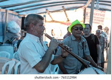 Unidentified Turkish Gypsy nomadic people performing music in tent restaurant at Pavli Fair Festival in Kirklareli,Turkey 19 October,2017