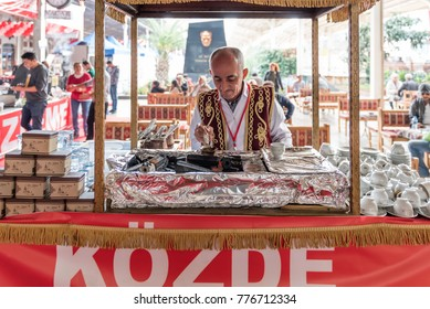 "Unidentified Turkish man in a Small coffee shop cooks ""Turkish Coffee on embers"" Istanbul,Turkey,28 October 2017"