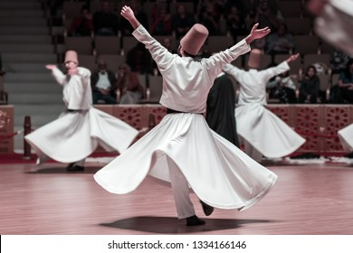 Unidentified whirling Dervishes or Semazen in Konya, Turkey