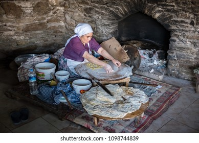 Unidentified woman Cooks traditional Turkish food Gozleme(pastries,pancake) on stove at Sirince Village,a popular destination in Selcuk,Izmir,Turkey. 21 August 2017