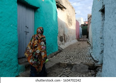 An Unidentified woman walking on the colorful streets in the old city of Harar, Ethiopia