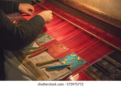Unidentified women weaving traditional chinese silk in Wuzhen, China