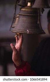 An unidentified young white male hand rings (tolls) a bell at Brahmavart Ghat, Bithoor (Bithur), Kanpur, Uttar Pradesh