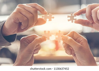 Unified synergy assembly business game implementation multiple puzzle meeting.Business connections strategy synergy team solution. Implement multiple game interaction puzzle. Hands holding puzzle