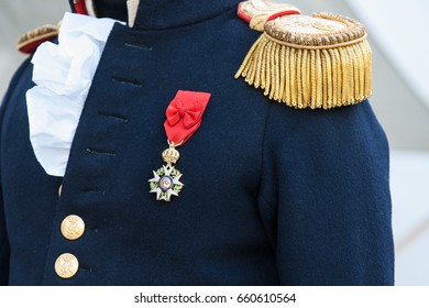 Uniform of a French army officer or general of Napoleon wars period decorated with a Napoleon imperial medal or order.