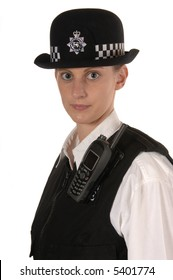 Uniformed UK female police officer looking to the front isolated on white