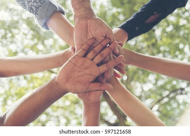 Unify communications collaboration.Mission vision business team building identity corporate teamwork industry and workforce.  Mission and strategy for business people holding hands together unified