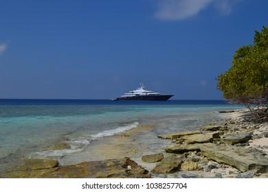 Uninhabited Island, Baa Atoll/Maldives - 02/09/2018: a yacht behind the reef