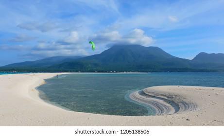 uninhabited white island on the background of Mount Hybec Hyboc and Mount Volcano, Camiguin, Philippines