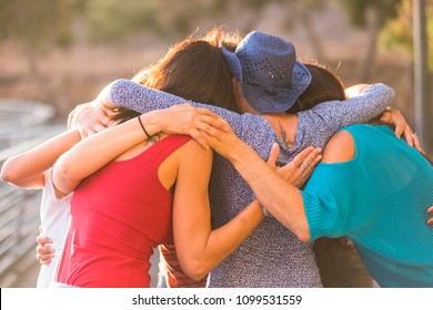 union all togehter like a team work and group of friends females 7 beautiful women hug all together under the sunlight and sunset for friendship and relationship and success concept. timeless friends.