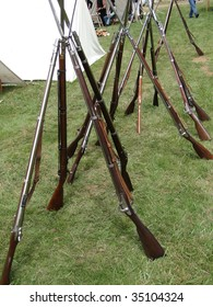 Union army rifles, stacked in camp,  Civil War Battle Re-enactment,  Port Gamble, WA