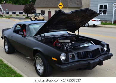 Union Grove, Wisconsin / USA - August 10, 2019:  A flat black mid 1970s Chevrolet Camaro at the local car show.