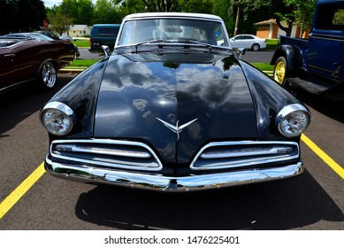 Union Grove, Wisconsin / USA - August 10, 2019: A beautiful 1953 Studebaker Commander image taken at high and wide angle on front to make the car appear as moving while parked.