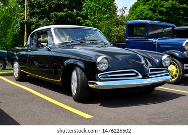 Union Grove, Wisconsin / USA - August 10, 2019: A beautiful restored 1953 Studebaker Commander with image taken at three quarter view to show front and passenger side.