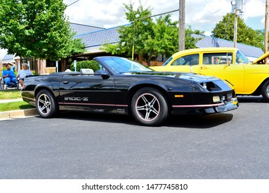 Union Grove, Wisconsin / USA - August 10, 2019:  A third generation Chevrolet Camaro Z/28 Convertible in black with the top down and tan inset interior at the local car show on a warm summer day.