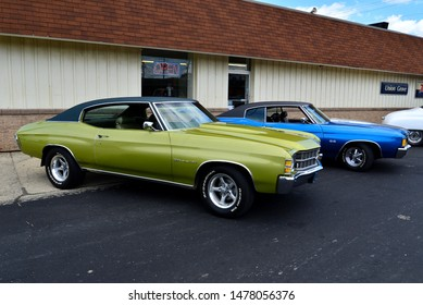 Union Grove, Wisconsin / USA - August 10, 2019: A light green 1971 Chevrolet Chevelle Malibu in front of a Blue 1972 Chevy SS next to it for comparison at the local car show. Both have black tops.