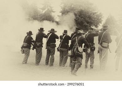 Union infantry line firing a volley,  Civil War Battle Re-enactment,  on Jun 20, 2009 in Port Gamble, WA.