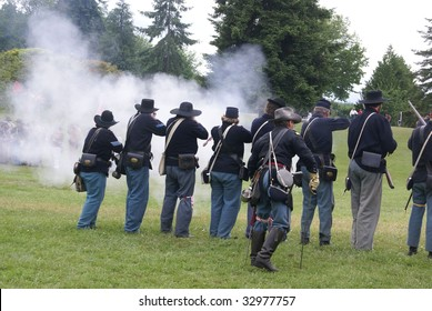 Union infantry line firing a volley,  Civil War Battle Re-enactment,  Port Gamble, WA