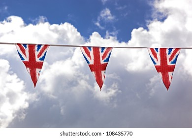 Union Jack bunting against typical English summer sky.