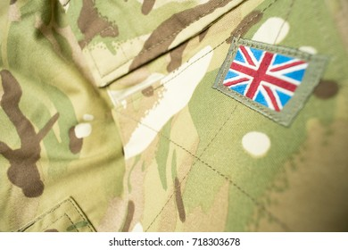 Union Jack / Union flag badge on a British army camouflage uniform. Potential text / writing / copy space around badge.
