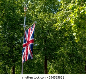 The Union Jack Flag flying from a flag pole on The Mall street. London.  England.  UK.  Taken in June 2015