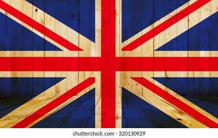 Union Jack flag on wooden background