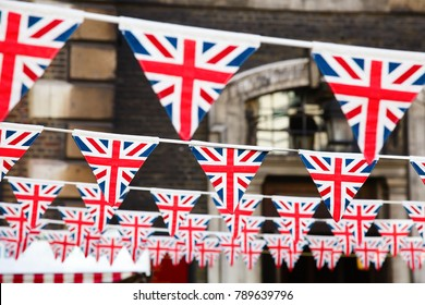 Union Jack flag triangular bunting hanging in a street, a festive decorations in London England UK