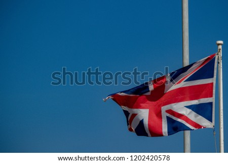 The Union Jack flying in Gibraltar. Gibraltar is a British Overseas Territory located on the southern tip of Spain.