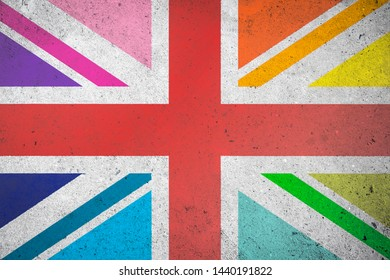 Union Jack UK flag with LGBTQI gay pride rainbow colored panels graffiti on a textured grunge concrete wall background