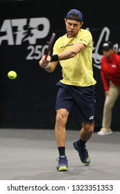 UNIONDALE, NEW YORK - FEBRUARY 14, 2019: Professional tennis player Radu Albot of Moldova in action during his round of 16 match at the 2019 New York Open tennis tournament in Uniondale, New York