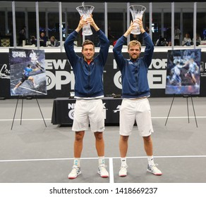 UNIONDALE, NEW YORK - FEBRUARY 17, 2019: 2019 New York Open doubles champions Kevin Krawietz (R) and Andreas Mies of Germany during trophy presentation after final match in Uniondale, New York