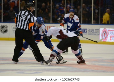 UNIONDALE, NEW YORK, UNITED STATES – FEB 8, 2014: NHL Hockey: Brock Nelson (New York Islanders) and Marc-Andre Cliché (Colorado Avalanche) during a face-off at Nassau Veterans Memorial Coliseum.