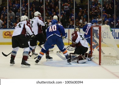 UNIONDALE, NEW YORK, UNITED STATES – FEB 8, 2014: NHL Hockey: New York Islanders on the attack in front of Colorado Avalanche goalie Jean-Sebastien Giguere at Nassau Coliseum. Michael Grabner, #40.