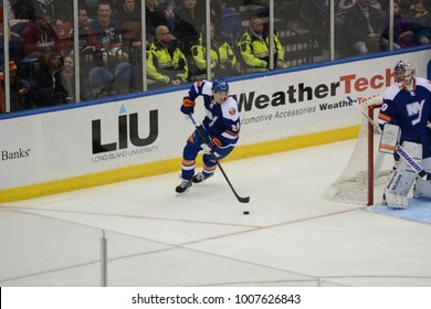UNIONDALE, NEW YORK, UNITED STATES – FEB 8, 2014: NHL Hockey: Brock Nelson, of the New York Islanders during a game against the Colorado Avalanche at Nassau Veterans Memorial Coliseum.