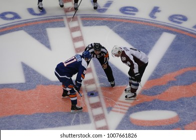 UNIONDALE, NEW YORK, UNITED STATES – FEB 8, 2014: NHL Hockey: John Tavares (New York Islanders) and Matt Duchene (Colorado Avalanche) face-off at Nassau Veterans Memorial Coliseum at start of game.