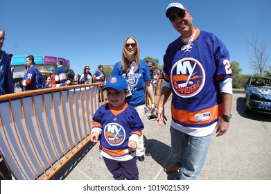 UNIONDALE, NEW YORK, UNITED STATES – May 5, 2013: NHL Hockey: New York Islanders fans tailgating and taking turns smashing a car in the parking lot prior to a playoff game against Pittsburgh Penguins.
