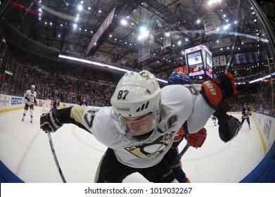 UNIONDALE, NEW YORK, UNITED STATES – May 5, 2013: NHL Hockey: Fish-eye view of corner battle btw. Sidney Crosby (Pittsburgh Penguins) and Travis Hamonic (New York Islanders) at Nassau Coliseum.