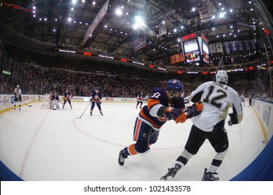 UNIONDALE, NEW YORK, UNITED STATES – May 5, 2013: NHL Hockey: Fish-eye view. Jarome Iginla (Pittsburgh Penguins) and Brian Strait (New York Islanders) battle in corner during game at Nassau  Coliseum.