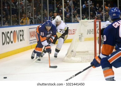 UNIONDALE, NEW YORK, UNITED STATES – May 5, 2013: NHL Hockey: Kyle Okposo, of the New York Islanders, and Evgeni Malkin, of the Pittsburgh Penguins, during a playoff game at Nassau Coliseum.